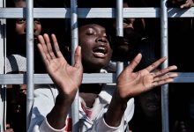Migrant behind bars in a Libyan detention centre. UNICEF/Romenzi.