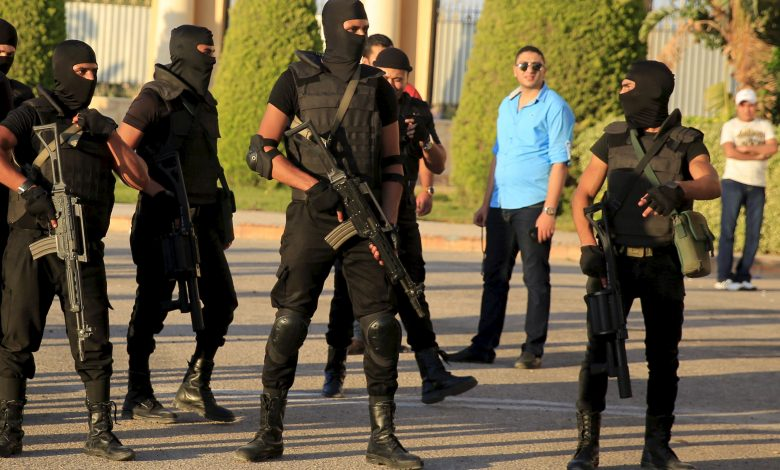 Egyptian police take their positions in front of the main gate at the Borg El Arab (Army) Stadium, where the Egyptian Premier League derby soccer match played without spectators due to 'security reasons', Alexandria, Egypt, 21 July 2015. Reuters, Amr Abdallah.