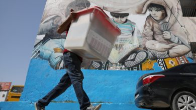 A polling agent carries a ballot box to a polling station, ahead of presidential election, Tunis, Tunisia, 14 September 2019. Reuters, Muhammad Hamed.