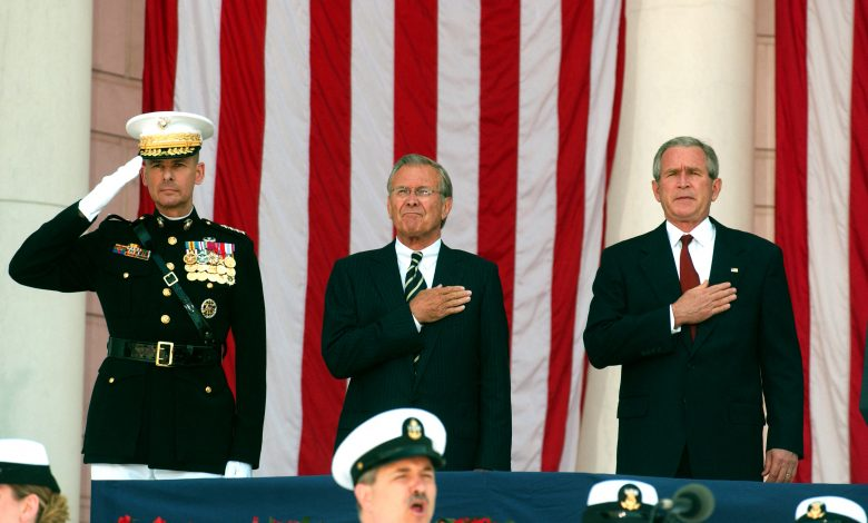 Former American George W. Bush with former Secretary of Defense Donald Rumsfeld at the National Cemetery in Arlington, Virginia, USA, 29 May 2006. Reuters, Ron Sachs, Pool.